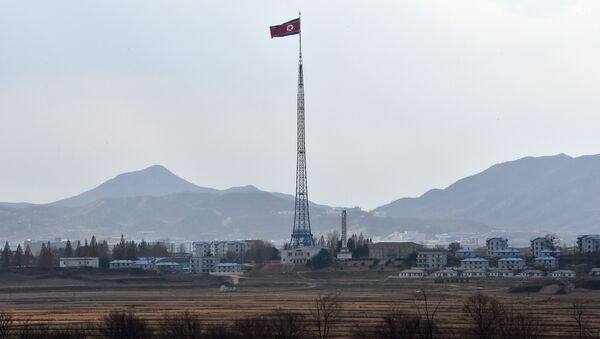 A North Korean flag flutters in the propaganda village of Gijungdong as seen from a South Korean military check point of the truce village of Panmunjom in the Demilitarized Zone dividing the two Koreas on November 12, 2014 - Sputnik International