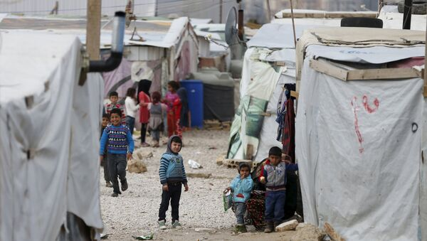 Syrian children are seen inside an informal settlement for Syrian refugees in Bar Elias, Bekaa valley, Lebanon, January 6, 2016 - Sputnik International