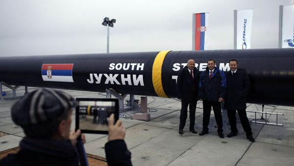 People have their photo taken next to the first section of the Gazprom South Stream natural gas pipeline in the town of Sajkas, 80 kilometers (50 miles) north of Belgrade, Serbia, Sunday, Nov. 24, 2013 - Sputnik International