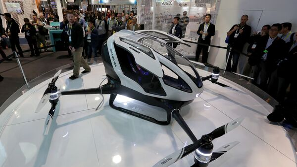 The newly-launched EHang 184 AAV (Autonomous Aerial Vehicle) that can autonomously fly a human passenger, programmed with an app, is displayed at the CES 2016 Consumer Electronics Show in Las Vegas, Nevada on January 7, 2016 - Sputnik International