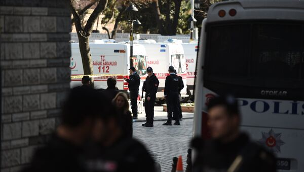 Turkish police stand next to ambulances as they block access to the Blue Mosque area on January 12, 2016 after a blast in Istanbul's tourist hub of Sultanahmet left 10 people dead - Sputnik International