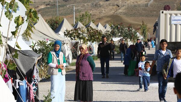 Syrian Refugees go about their daily lives at the refugee camp in Osmaniye on December 15, 2015 - Sputnik International