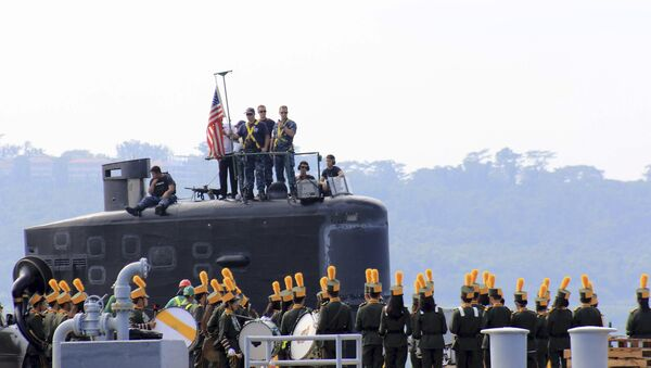 A local marching band welcomes the arrival of sailors aboard the USS Topeka (SSN-754), a Los Angeles-class submarine, as it prepares to be docked at the Alava pier off Subic port in Zambales province for a three-day port call at northwestern Philippines, Tuesday, Jan. 12, 2016 - Sputnik International
