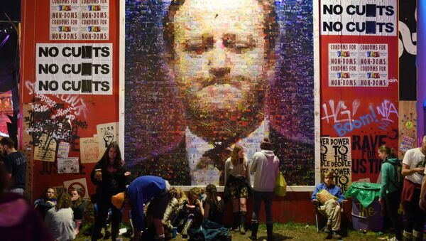A large mural depicting British Prime Minster David Cameron is displayed in the Hell section of the Shangri La area of the Glastonbury Festival - Sputnik International