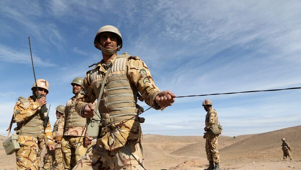 Iranian soldiers participate in military manoeuvres. File photo - Sputnik International