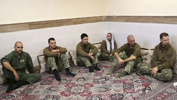 This picture released by the Iranian Revolutionary Guards on Wednesday, Jan. 13, 2016, shows detained American Navy sailors in an undisclosed location in Iran. Less than a day after 10 U.S. Navy sailors were detained in Iran when their boats drifted into Iranian waters, they and their vessels were back safely Wednesday with the American fleet - Sputnik International