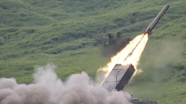 Ground Self-Defense Force anti-land mine missile is launched during an annual live firing exercise - Sputnik International