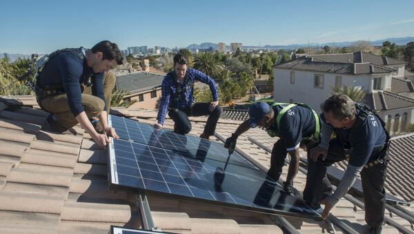 In this handout photograph provided by Sunrun, real estate experts install solar panels on a home in Las Vegas. - Sputnik International