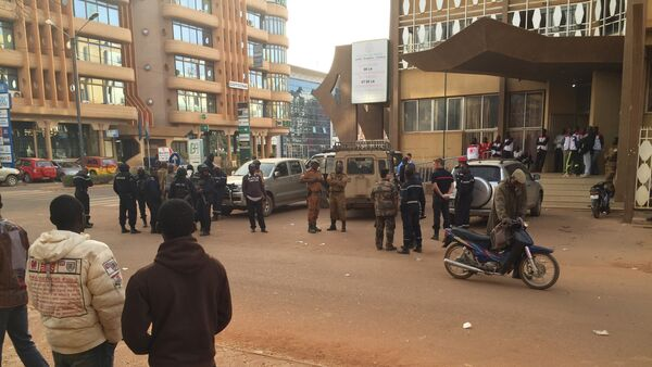 Security forces gather near the Hotel that was attacked by suspected militants in Ouagadougou, Burkina Faso, Saturday, Jan. 16, 2016 - Sputnik International
