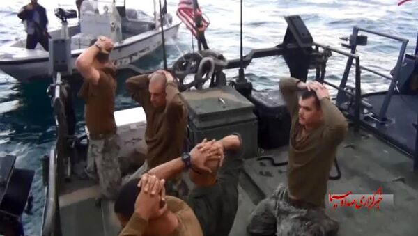 This frame grab from Tuesday, January 12, 2016 video by the Iranian state-run IRIB News Agency, shows detention of American Navy sailors by the Iranian Revolutionary Guards in the Persian Gulf, Iran - Sputnik International