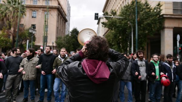 A demonstrator shouts slogans in a megaphone during a rally in central Athens on January 16, 2016 called by Greek main workers' unions to condemn a planned overhaul of Greece's pension system demanded by its international creditors. - Sputnik International