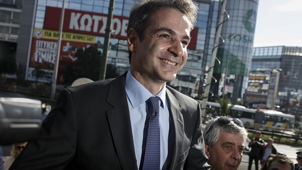 Newly elected leader of Greece's conservative New Democracy party Kyriakos Mitsotakis arrives at the party's headquarters, a day after winning the party elections, in Athens, Greece January 11, 2016 - Sputnik International
