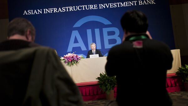 Jin Liqun (C), the first president of the Asian Infrastructure Investment Bank (AIIB), speaks to journalists during a press conference in Beijing on January 17, 2016 - Sputnik International
