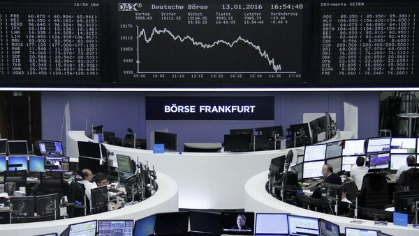 Traders work at their desks in front of the German share price index, DAX board, at the stock exchange in Frankfurt, Germany, January 13, 2016 - Sputnik International