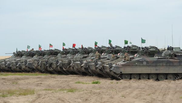 German army tanks line up during the course of the NATO Noble Jump exercise on a training range near Swietoszow Zagan, Poland, June 2015. The German military has seen an increase in deployments for exercises in Eastern Europe and on Russia's borders since the start of the Ukrainian crisis in February 2014. - Sputnik International