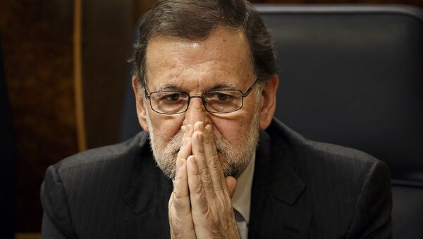 Spain's Acting Prime Minister Mariano Rajoy sits on his chair at the Spanish Parliament in Madrid, Wednesday, Jan. 13, 2016 - Sputnik International