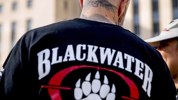 A former member of Blackwater joines family members, friends, and supporters of four former Blackwater security guards outside the federal court in Washington, Monday, April 13, 2015 - Sputnik International