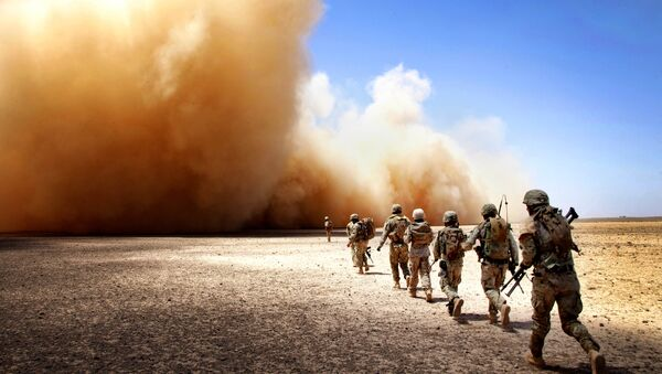 U.S. Marines assigned to Georgian Liaison Team-9 and Georgian Army soldiers assigned to the 33rd Light Infantry Battalion make their way to the extraction point during Operation Northern Lion II in Helmand province, Afghanistan, July 3, 2013 - Sputnik International