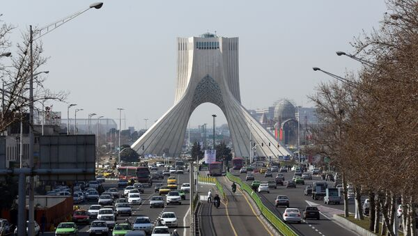 A picture taken on January 18, 2016 shows vehicles driving on a street in front of the Azadi Tower in the capital Tehran - Sputnik International