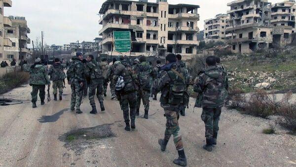 Syrian government troops and allied militiamen walk inside the key town of Salma in Latakia province, Syria. - Sputnik International