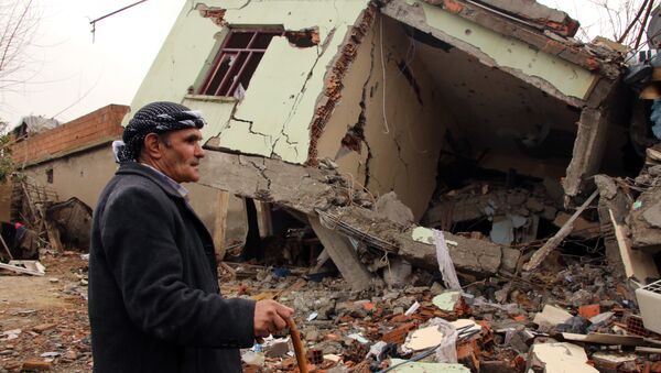 A resident walks on the rubble of a destroyed house in the mostly-Kurdish town of Silopi, in southeastern Turkey. - Sputnik International