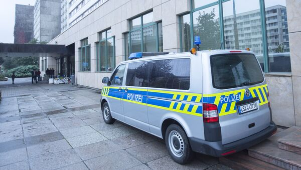 A police car stands in front of the initial reception center for asylum seekers in Halle/Saale, Germany, Friday, Oct. 16, 2015 - Sputnik International