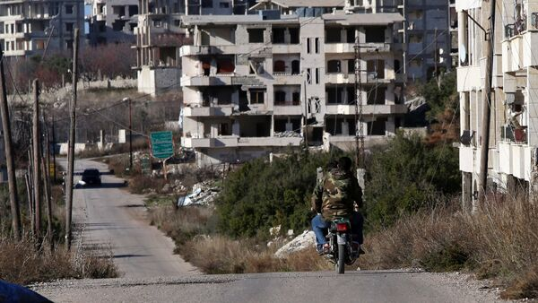 Syrian army soldiers ride a motorcycle in the village of Salma, in the northwestern province of Latakia on January 15, 2016 - Sputnik International