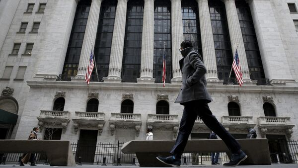 A man passes by the New York Stock Exchange in New York's financial district January 15, 2016 - Sputnik International