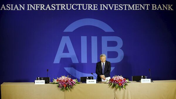 President of Asian Infrastructure Investment Bank (AIIB) Jin Liqun greets to journalists as he arrives at a news conference in Beijing January 17, 2016 - Sputnik International