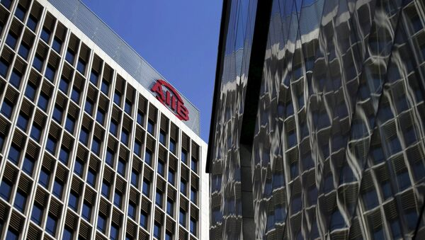 The logo of Asian Infrastructure Investment Bank (AIIB) is seen at its headquarter building in Beijing January 17, 2016 - Sputnik International