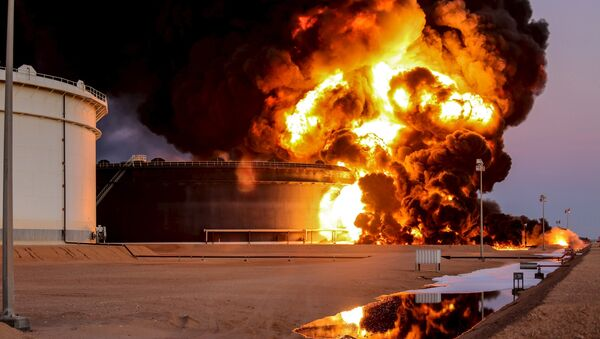 Fire rises from an oil tank in the port of Es Sider, in Ras Lanuf, Libya, in this file picture taken January 4, 2016. - Sputnik International