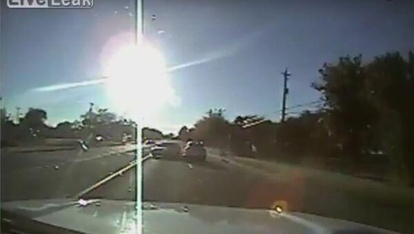 Teens driving stolen car hit cop cruiser - Sputnik International