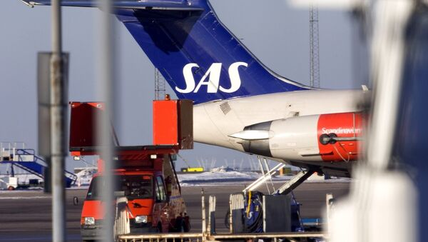 An airplane stands at the ramp of the tarmac of Landvetter Airport outside Goteborg, Sweden - Sputnik International