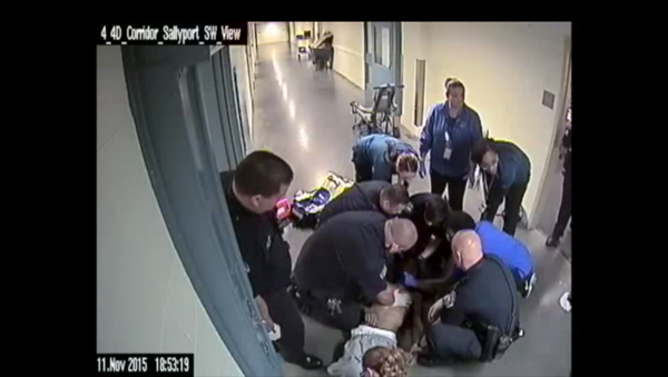 Screenshot of a video from a jail in Denver showing a police response to an inmate choking to death - Sputnik International