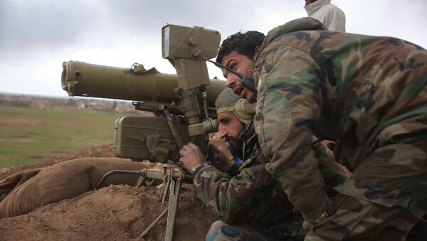 Syrian pro-government forces adjust a man-portable anti-tank system (MANPAT) as they hold a position in the Hatabat al-Bab area, near town of Al-Bab in Aleppo's eastern countryside, on January 24, 2016, during a military operation against Islamic State (IS) group jihadists - Sputnik International
