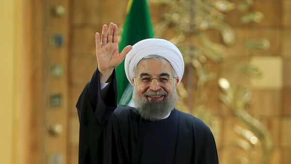 Iranian President Hassan Rouhani waves during a news conference in Tehran, Iran January 17, 2016. - Sputnik International