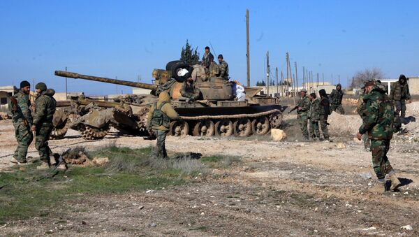 Syrian pro-government troops hold positions in the Syrian town of Ain al-Hanash near l-Bab in Aleppo's eastern countryside on January 26, 2015 as regime forces have recaptured the area from Islamist jihadists - Sputnik International