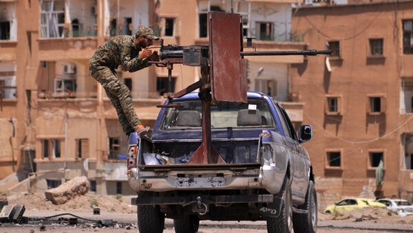 A member of the Kurdish People's Protection Units (YPG) mans a mounted machine gun in the Al-Nashwa neighbourhood in the northeastern Syrian province of Hasakeh on July 26, 2015 - Sputnik International