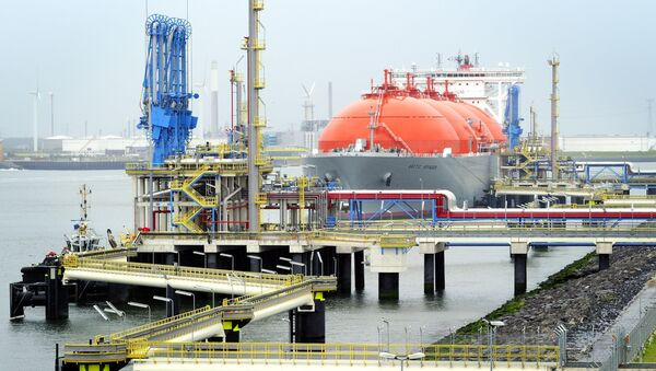 The LNG carrier, a tank ship designed for transporting liquefied natural gas, Arctic Voyager is setting for sail in the port of Rotterdam, The Netherlands on July 6, 2011 - Sputnik International