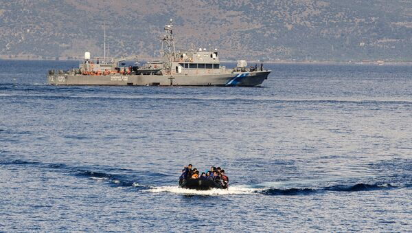 A Greek coast guard ship is seen behind a rubber boat with refugees and migrants near the Greek island of Lesbos after crossing the Aegean Sea from Turkey on October 13, 2015 - Sputnik International
