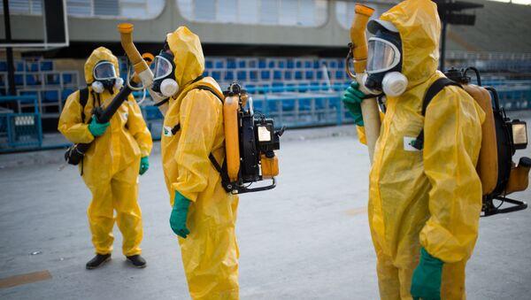 Municipal agents spray anti Zika mosquitos chimical product at the sambadrome in Rio de Janeiro, on January 26, 2016 - Sputnik International