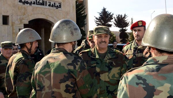 Syria's General Fahd Jassem al-Freij (C), Deputy Commander-in-Chief of the Army and the Armed Forces and Minister of Defense allegedly visiting troops in the northern Syrian city of Aleppo. (File) - Sputnik International
