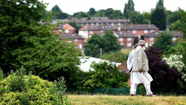 People walk in a park in Savile Town, Dewsbury - Sputnik International