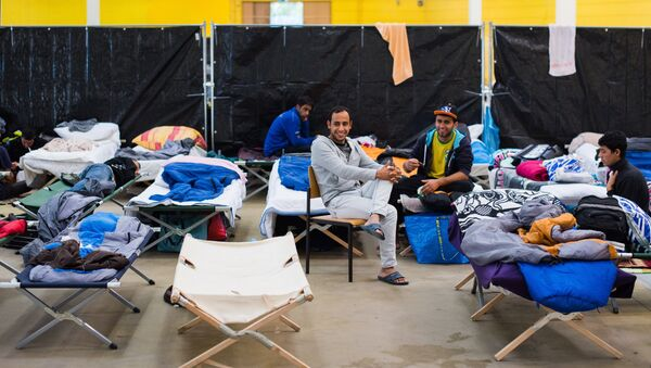 Refugees are seen in their temporary housing in a former hardware store in Hamburg, northern Germany. - Sputnik International