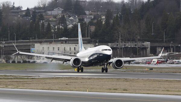 A Boeing 737 MAX returns from a flight test at Boeing Field in Seattle, Washington - Sputnik International