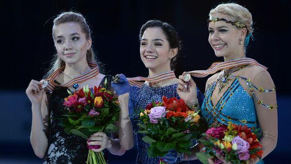Medalists of the women's free skating program at the European Figure Skating Championships in Bratislava, Slovakia, during the awards ceremony, from left: Elena Radionova (Russia) - silver medal; Evgenia Medvedeva (Russia) - gold medal; Anna Pogorilaya (Russia) - bronze medal - Sputnik International