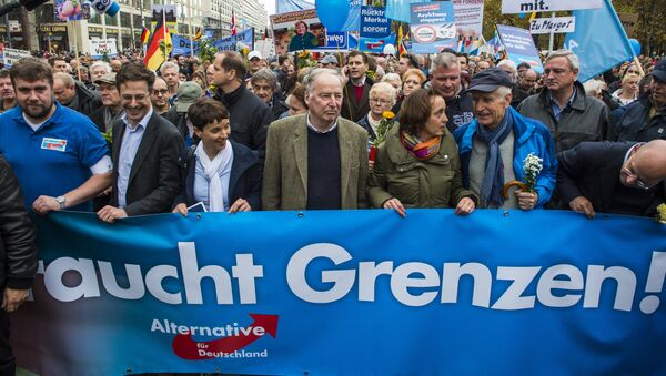 Frauke Petry (3rd, L), chairman of the right-wing populist Alternative for Germany (AfD) party, and the AfD's leading politician Alexander Gauland (4th, L) hold a banner reading Asylum needs limits during a demonstration against the German government's asylum policy organized by the AfD party in Berlin on November 7, 2015. - Sputnik International