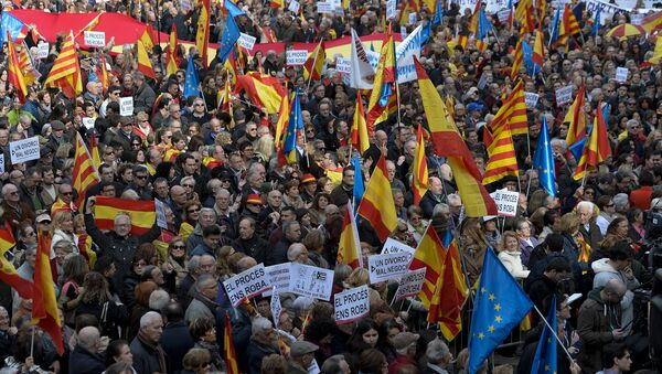Demonstrators wave European, Spanish and Catalan flags during a demonstration called by Sociedat Civil Catalana (Catalan Civil Society) to support the unity of Spain, at Catalonia square in Barcelona - Sputnik International