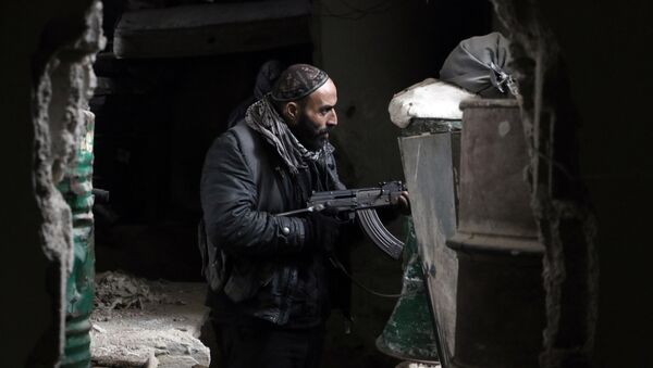 A fighter from the Jaish al-Islam (Islam Army), the foremost rebel group in Damascus province guards a position on the front line in Jobar, on the eastern edge of the Syrian capital - Sputnik International