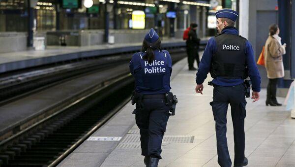 Belgian police officers patrol on a platform at the Thalys high-speed train terminal at Midi/Zuid railway station in Brussels, Belgium, January 7, 2016 - Sputnik International